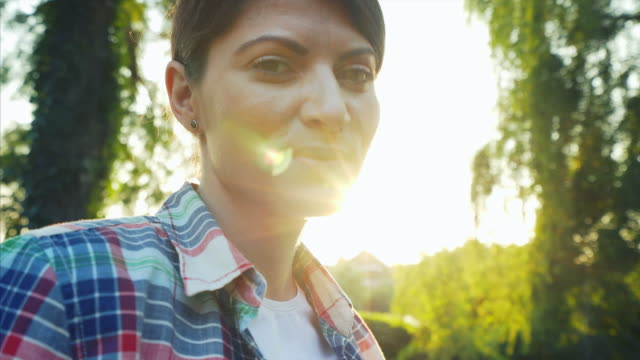woman portrait at sunset. - speranza video stock e b–roll