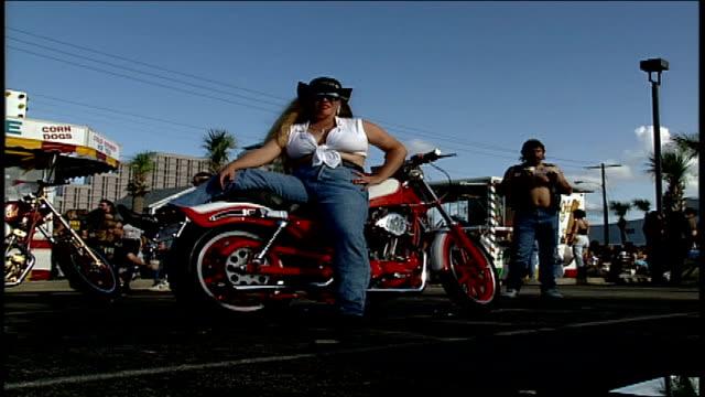 woman posed on top of red motorcycle in daytona florida - motorcycle biker stock videos & royalty-free footage