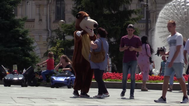 woman poses for a photo with an animator dressed in a bear costume on the independence square in downtown kiev, ukraine, 16 july 2019. - animator stock videos & royalty-free footage