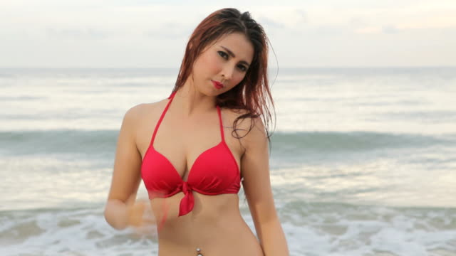 woman posing at beach - swimwear stock videos and b-roll footage