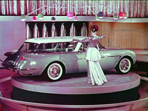 1954 woman posing by chevrolet nomad station wagon on spinning platform at motorama - chevrolet stock videos & royalty-free footage