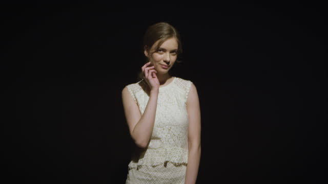 woman posing on dark background - white dress stock videos & royalty-free footage