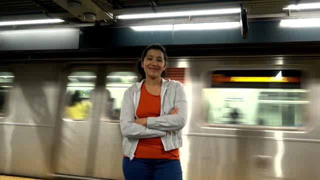 woman posing on nyc subway platform, new york city - arms crossed stock videos & royalty-free footage