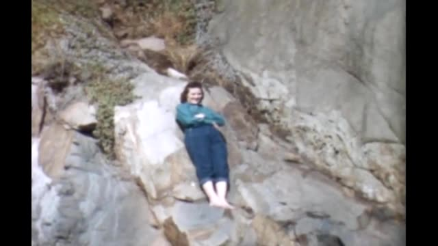 1965 woman posing on rocks - thigh stock videos & royalty-free footage