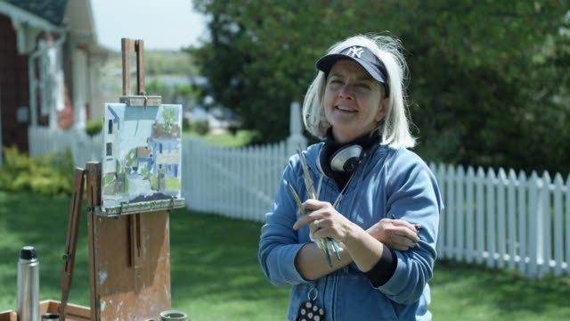 ms woman posing with painting, essex, connecticut, usa - only mature women stock videos & royalty-free footage