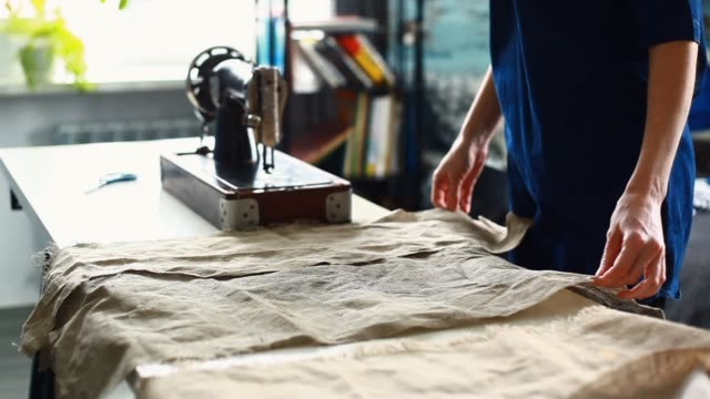 Woman positioning pieces of linen