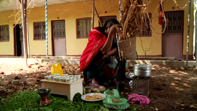 woman pouding roasted coffee grains for coffee ceremony - ethiopia stock videos & royalty-free footage
