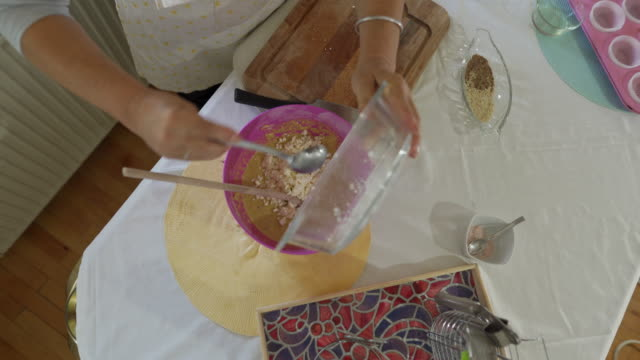 woman pouring cheese into a flour mix - crumb stock videos & royalty-free footage