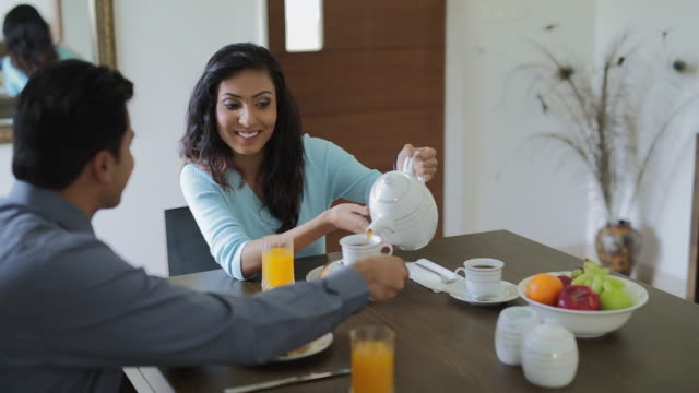 ms woman pouring coffee at table / india - indian couple tea stock videos & royalty-free footage