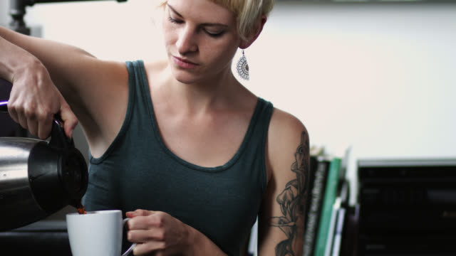 woman pouring coffee - nose ring stock videos & royalty-free footage