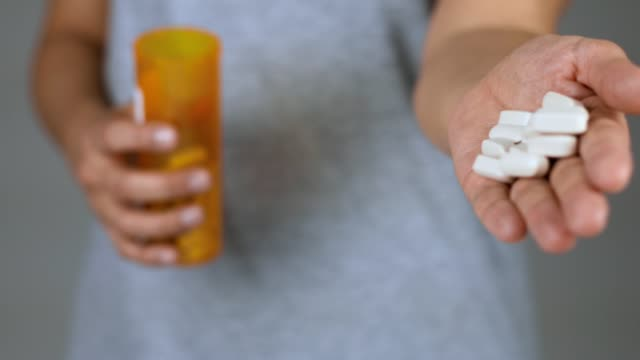 woman pouring excessive amount of pills to ground - anti impotence tablet stock videos & royalty-free footage