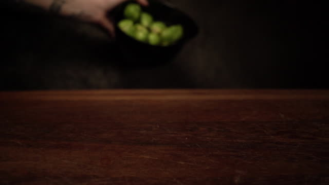woman pouring out brussels sprouts on the cutting board - rolling stock videos & royalty-free footage
