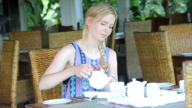 woman pouring tea in a cafe - tea pot stock videos and b-roll footage