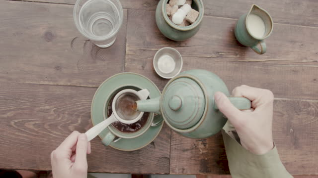 woman pouring tea - tea cup stock videos & royalty-free footage