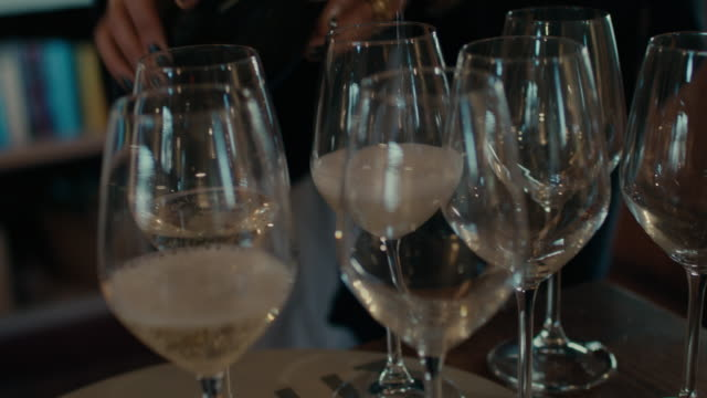 woman pouring wine, champagne - white wine stock videos & royalty-free footage