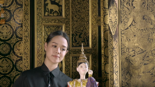 woman practice traditional thai puppet - puppet stock videos & royalty-free footage
