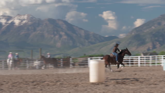 woman practicing barrel racing - cowgirl stock videos & royalty-free footage