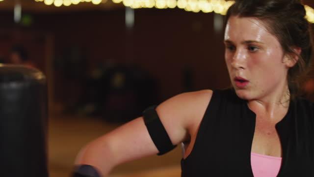 cu woman practicing kick boxing in gym / draper, utah, usa - kickboxing stock videos & royalty-free footage