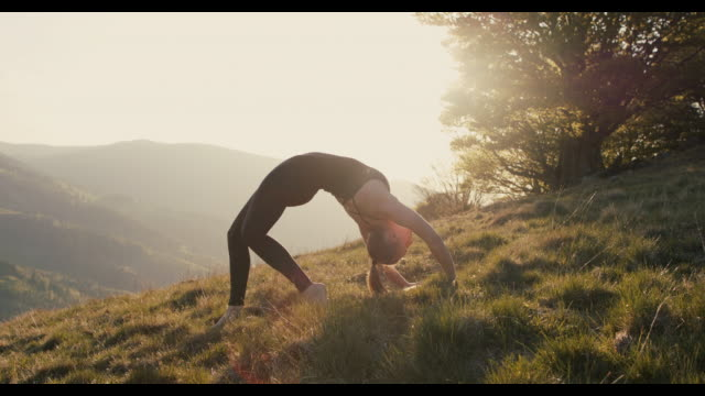 woman practicing yoga against spectacular scenery - nature stock videos & royalty-free footage