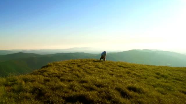 HD: Woman Practicing Yoga On The Ridge