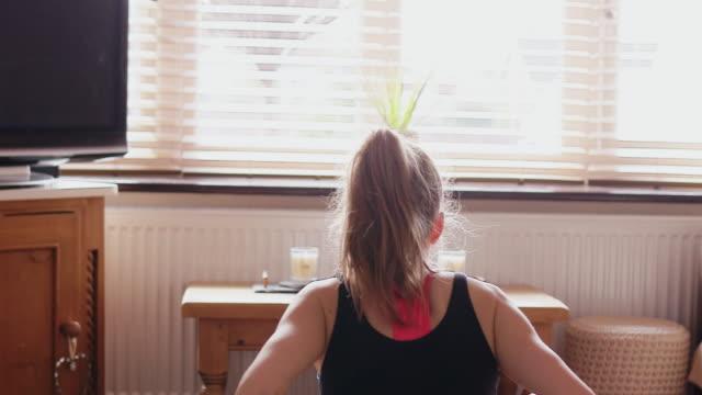 stockvideo's en b-roll-footage met woman practicing yoga - bukken
