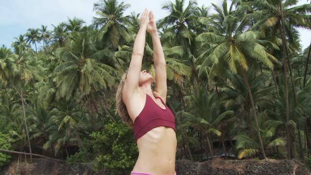 stockvideo's en b-roll-footage met woman practicing yoga - menselijke arm