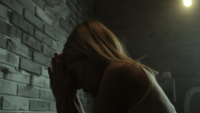woman praying at prison cell - praying stock videos & royalty-free footage