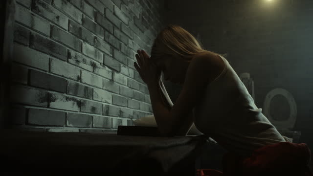 woman praying at prison cell - women prison stock videos & royalty-free footage