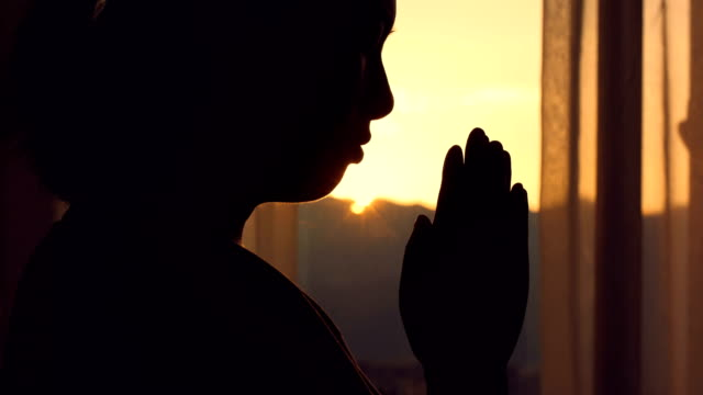 woman praying at sunset - harmony stock videos & royalty-free footage