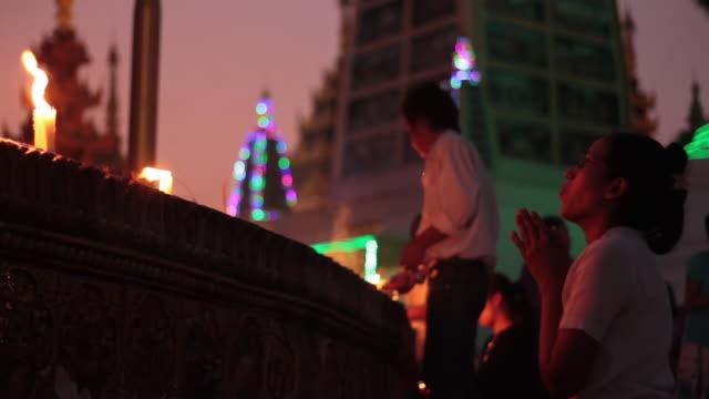 woman praying in Myanmar