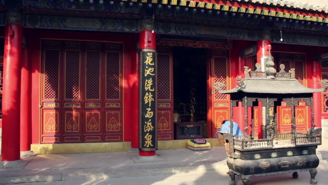 ws woman praying in temple/xian,shaanxi,china - one mid adult woman only stock videos & royalty-free footage