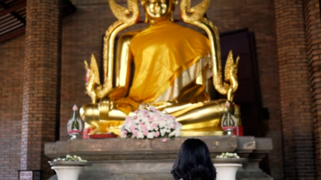 woman praying in the ancient temple - buddha stock videos & royalty-free footage