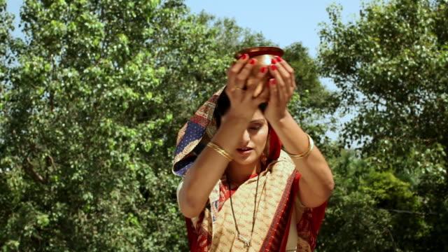 woman praying surya namaskar  - sun salutation stock videos & royalty-free footage