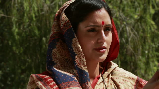 woman praying surya namaskar  - sun salutation stock videos and b-roll footage