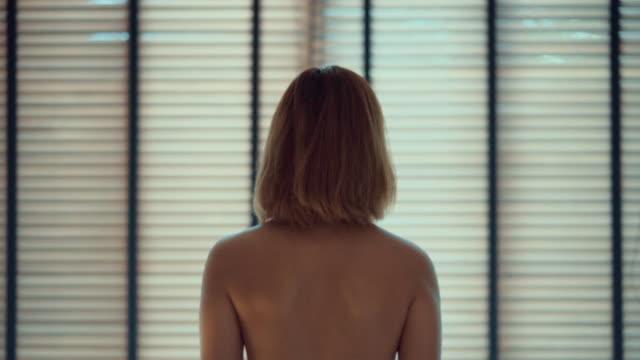 woman prepare to shower in bath room - bathrobe stock videos & royalty-free footage