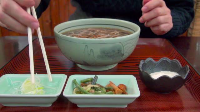 Woman prepares to eat soba noodles near Minakami, Gunma, Japan