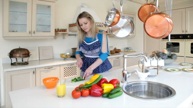 woman prepares vegetable salad in the kitchen - cooking pan stock videos & royalty-free footage