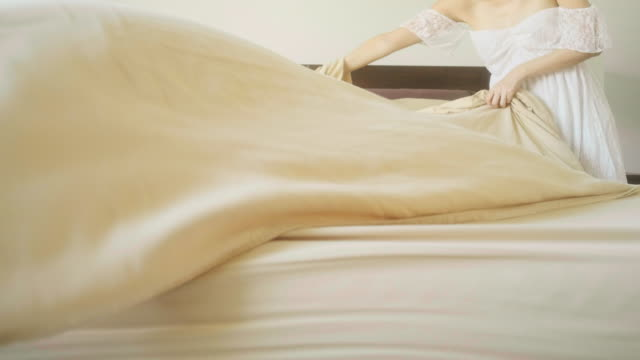woman preparing a bed - sheet stock videos & royalty-free footage