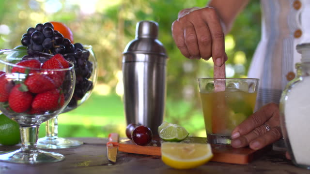 woman preparing a caipirinha - bar drink establishment stock videos & royalty-free footage