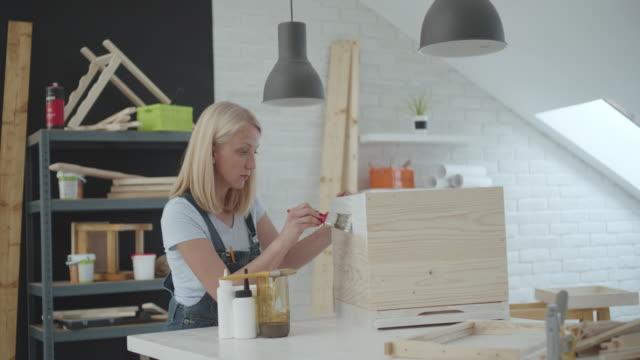 woman preparing beehive in workshop - beehive stock videos & royalty-free footage