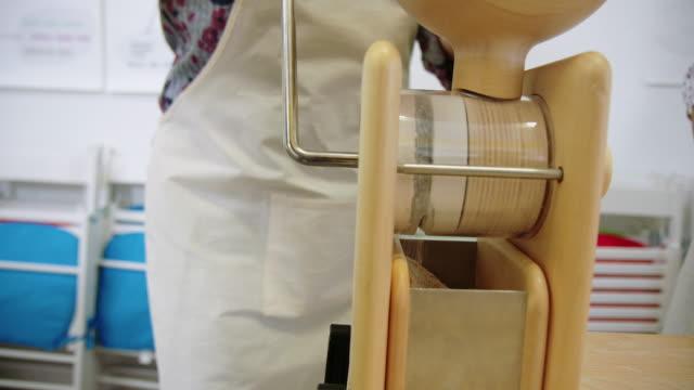 woman preparing fine flour at pasta workshop - flour mill stock videos & royalty-free footage