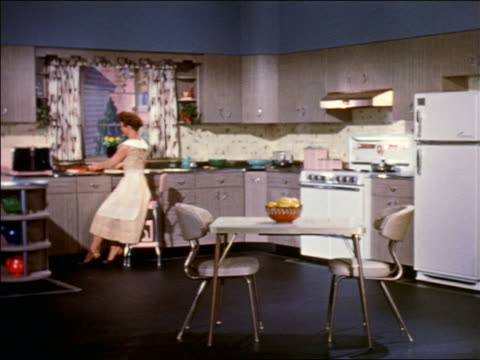1959 woman preparing food at counter in kitchen / industrial - stay at home mother stock videos & royalty-free footage