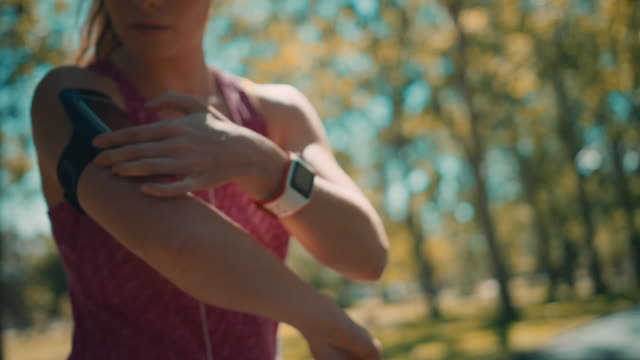 woman preparing for jogging - smart watch stock videos & royalty-free footage