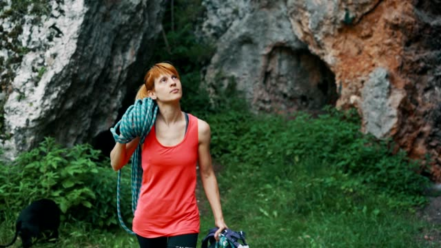 woman preparing for rock climbing - krab stock videos & royalty-free footage