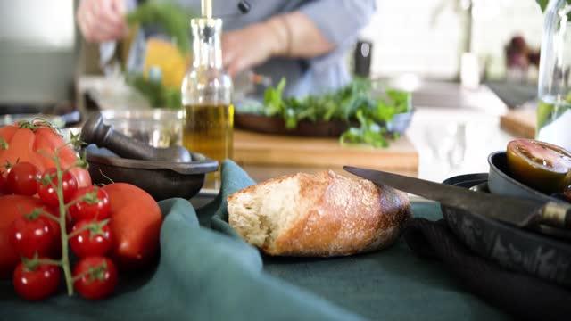 woman preparing fresh herbs in kitchen - chopping board stock videos & royalty-free footage
