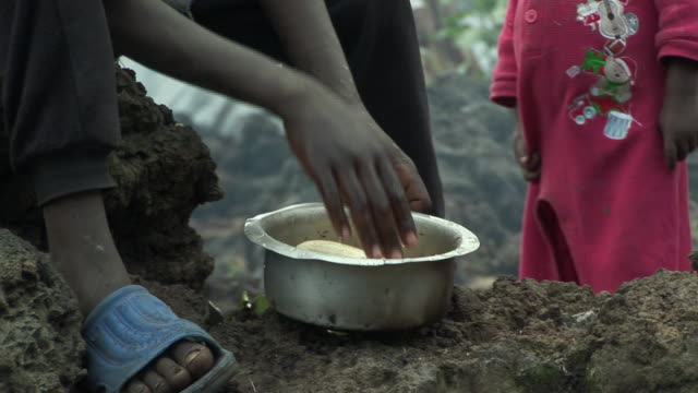 CU Woman preparing manioc, Refugee Camp, Goma, Congo