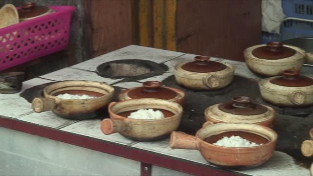 MS ZI ZO CU Woman preparing rice in bar, Yangshuo, Guangxi, China