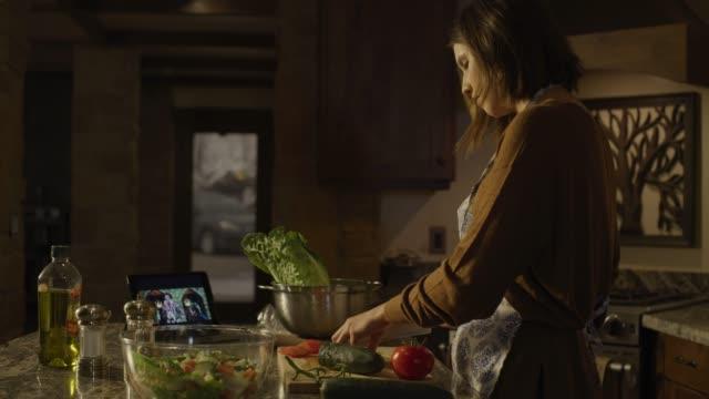 woman preparing salad and watching digital tablet in kitchen / cedar hills, utah, united states - brown hair stock videos & royalty-free footage