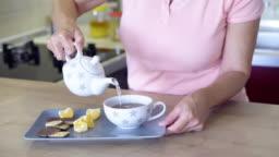 Woman preparing  tea at home