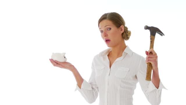 woman preparing to break into her piggy bank - 25セント硬貨点の映像素材/bロール